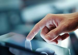 hand presses on screen digital tablet