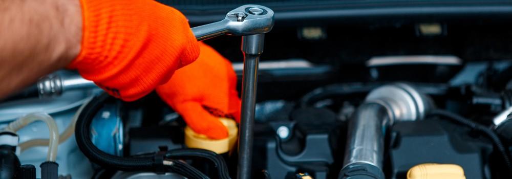 A man fixing a car