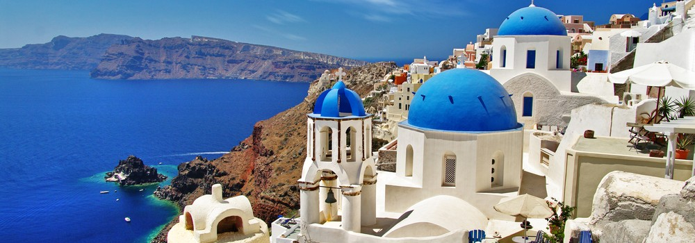 white-blue Santorini view of caldera with domes