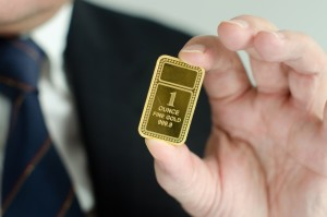 Gold bar held by a business man