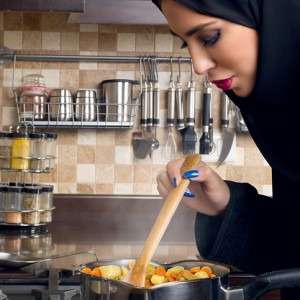An Arab woman cooking in her kitchen