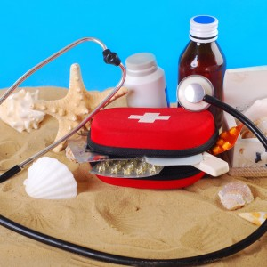 stethoscope on the beach as healthy summer holiday concept