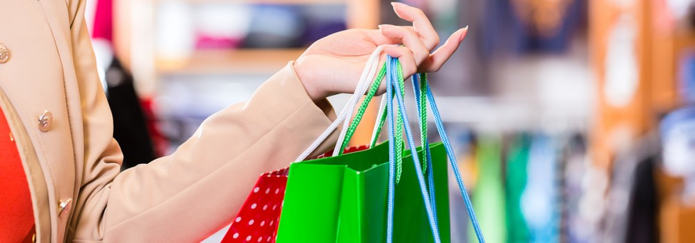 A woman holding shopping bags in her arms
