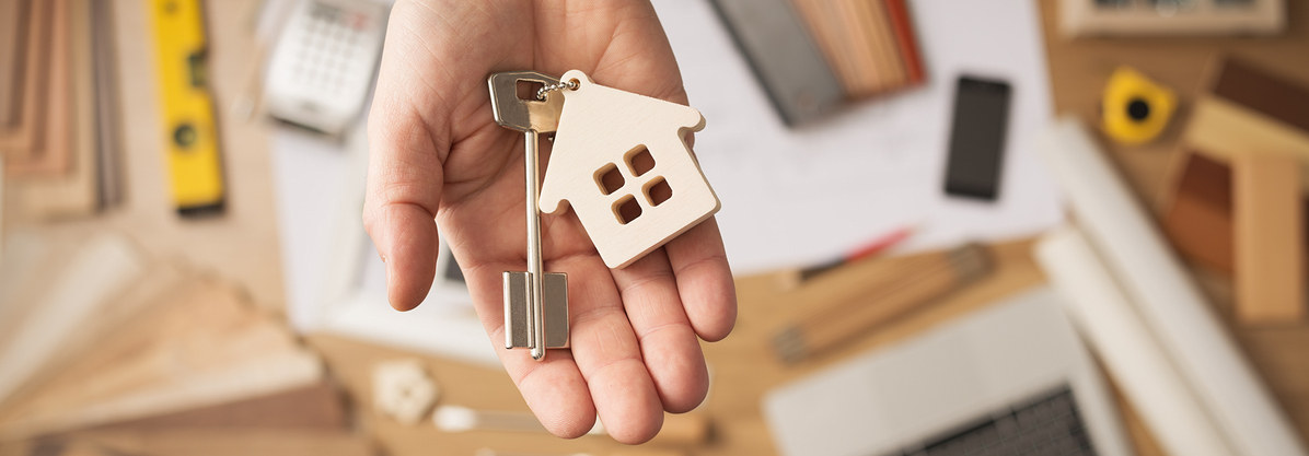 Real estate agent handing over a house key rendered