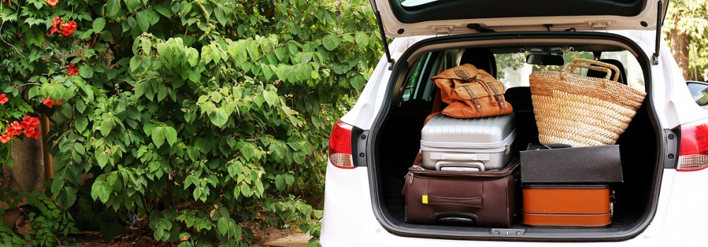 Suitcases and bags in trunk of car ready to depart for road trip