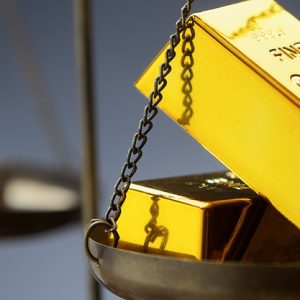 Investing in gold on the scales rendered