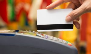 Hand Swiping Credit Cards In Store rendered