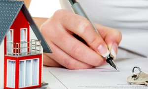 woman signing home insurance contract