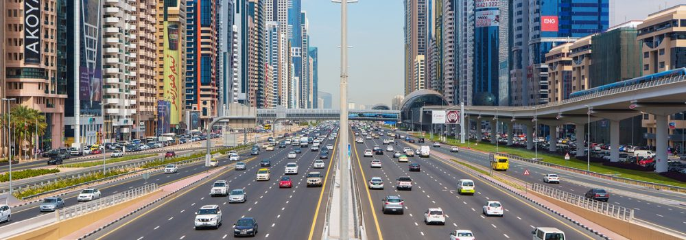 Busy Shaek Zayed Road, metro railway and modern skyscrapers and car insurance