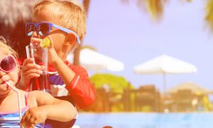 travel insurance - kids relax on tropical beach resort original (2)