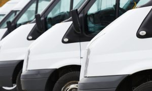 commercial fleet motor insurance delivery vans in row at parking place of transporting carrier shipping service company