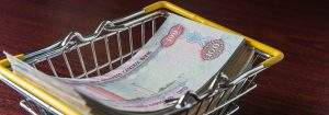 Loans - Hundred dirham notes placed in a shopping cart rendered