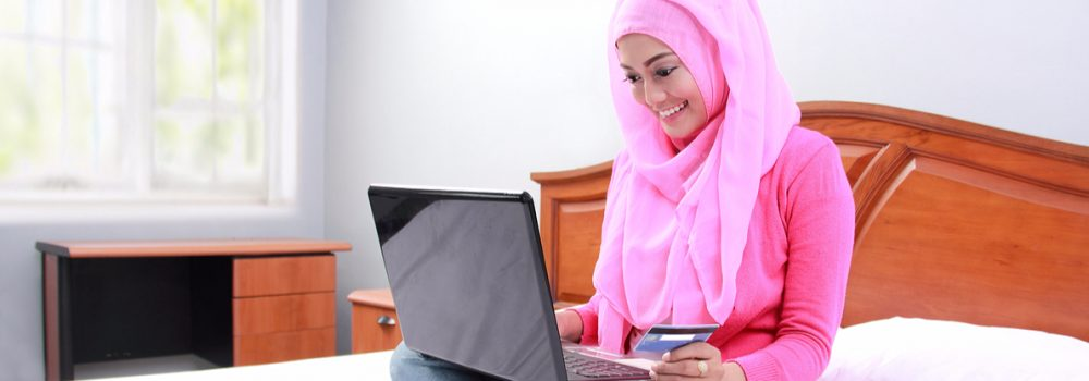 muslim woman using credit card