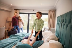 children-playing-on-hotel-bed