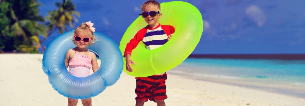 little-boy-and-toddler-girl-play-on-beach-rendered