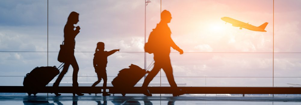 silhouette of family travelling