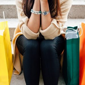 Woman with colorful shopping bags rendered
