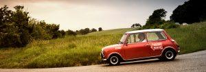 :mini cooper old racing car in rally Mille Miglia