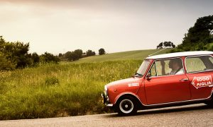 :mini cooper old racing car in rally Mille Miglia
