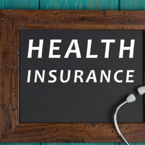 health-insurance-book-pills-and-stethoscope-rendered