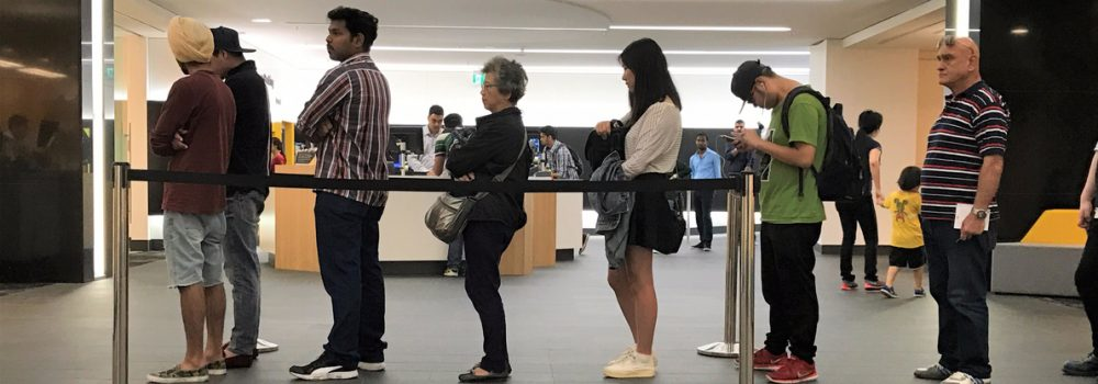 people-standing-in-a-queue-in-a-bank-branch-rendered