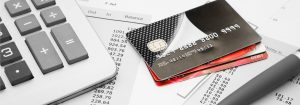 credit-cards-with-credit-card-statementspen-and-calculator-rendered
