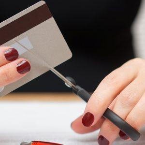 woman-is-cutting-credit-card-debt-rendered