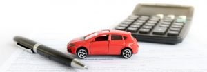 car-insurance-black-ballpoint-pen-calculator-and-red-car-rendered