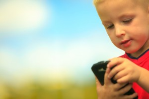 Kid playing with mobile phone